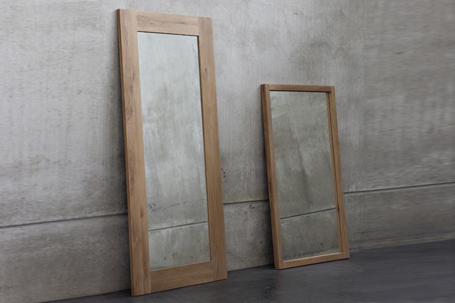 Indret dig med spejle i boligen for at skabe rummelighed i rummene.