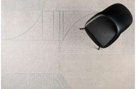 Her ses et billede af Bliss tæppet i grå og blå fra Zuiver.