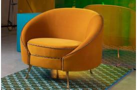 Denne Bold Monkey lænestol vil sikkert tilføje noget luksuriøsitet til din bolig.