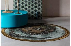 Dette jordinspirerede tæppe kan være den perfekte prik over i'et i din indretning.