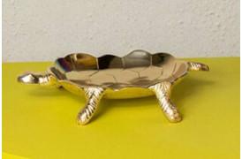 Denne skildpaddelignende bakke kan bruges til opbevaring af accessories.