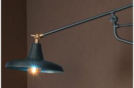 Billedet viser Devi væglampen fra Dutchbone i farven Blågrøn.