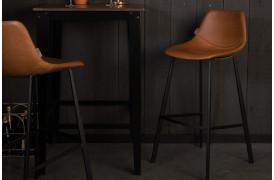 Her ses et billede af Franky barstolen i brun.