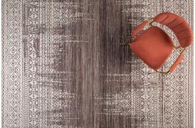 Her ses et billede af Liv tæppet i farven Plum fra Decoholic.