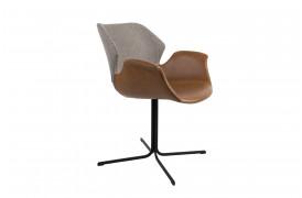 Billede af Nikki spisebordsstolen fra Zuiver i brun læder og lysegråt stof.