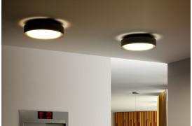 Billedet viser to Plaff-on loftslamper fra Marset i en bolig.