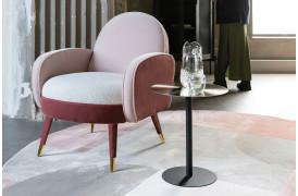 Her ses et billede af Sam loungestolen i pink fra Zuiver.