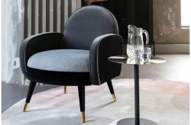 Her ses et billede af Sam loungestolen i sort fra Zuiver.