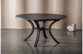 Det æstetiske og smukke kurvede ben på Paris spisebordet har et praktisk formål.
