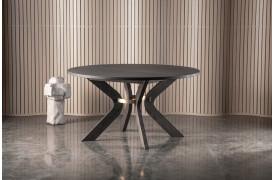 Sydney spisebordet kan let kendes på metaldetaljen på det kurvede ben.